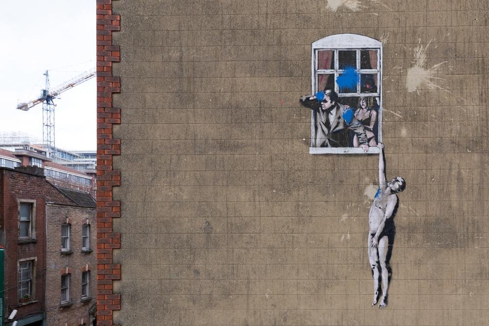 Piece by Banksy in Bristol, UK.