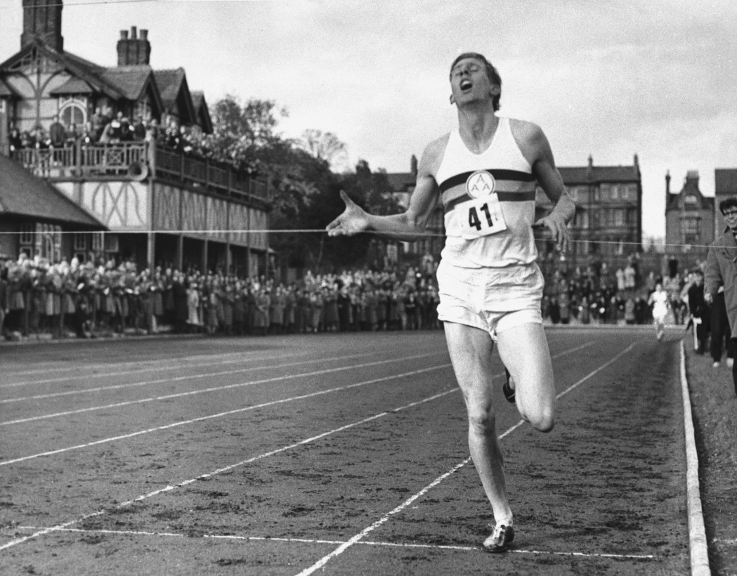 ADVANCE FOR WEEKEND EDITIONS, MAY 3-4 - FILE - In this May 6, 1954, file photo, British Athlete Roger Bannister breaks the tape to become the first man ever to break the four minute barrier in the mile at Iffly Field in Oxford, England. With the 60th anniversary approaching, Bannister, now 85, is reliving those four minutes that still endure as a seminal moment in sports history. He has a new autobiography out and is marking the anniversary with a series of events at Oxford, where he set the record on a cinder track all those years ago. (AP Photo/File)