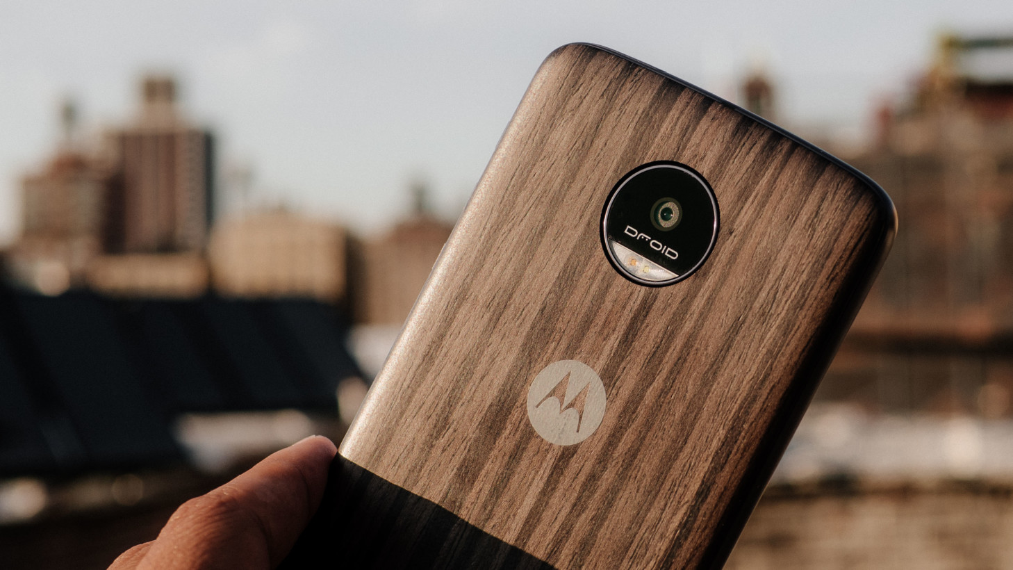 The Moto Z is packaged with a Style Mod, at least on Verizon, so you don't have to see the 'real'back unless you want to. Notice the camera is now flush with the body.