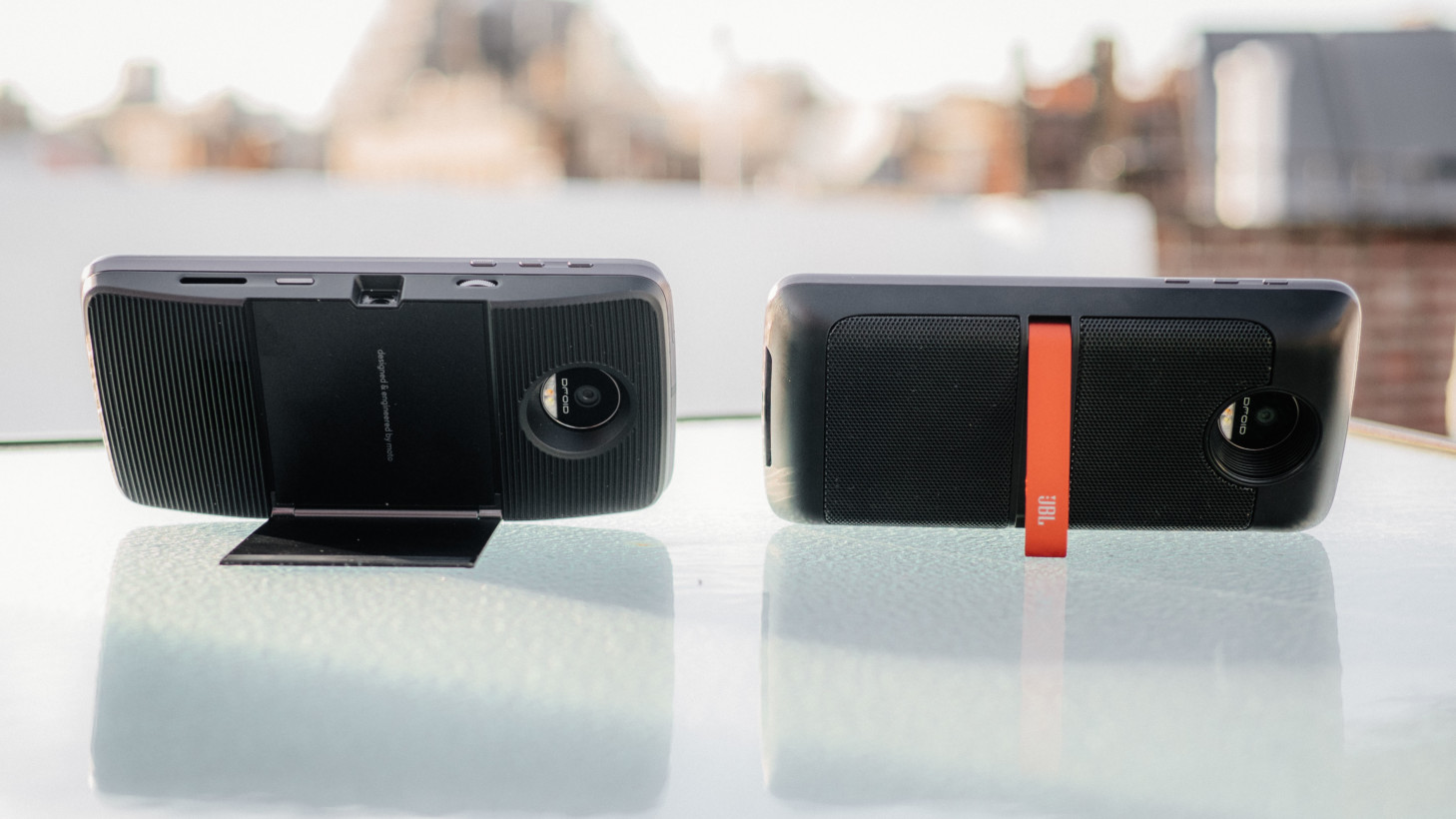 Left: Insta-share projector. Right: JBL SoundBoost speakers
