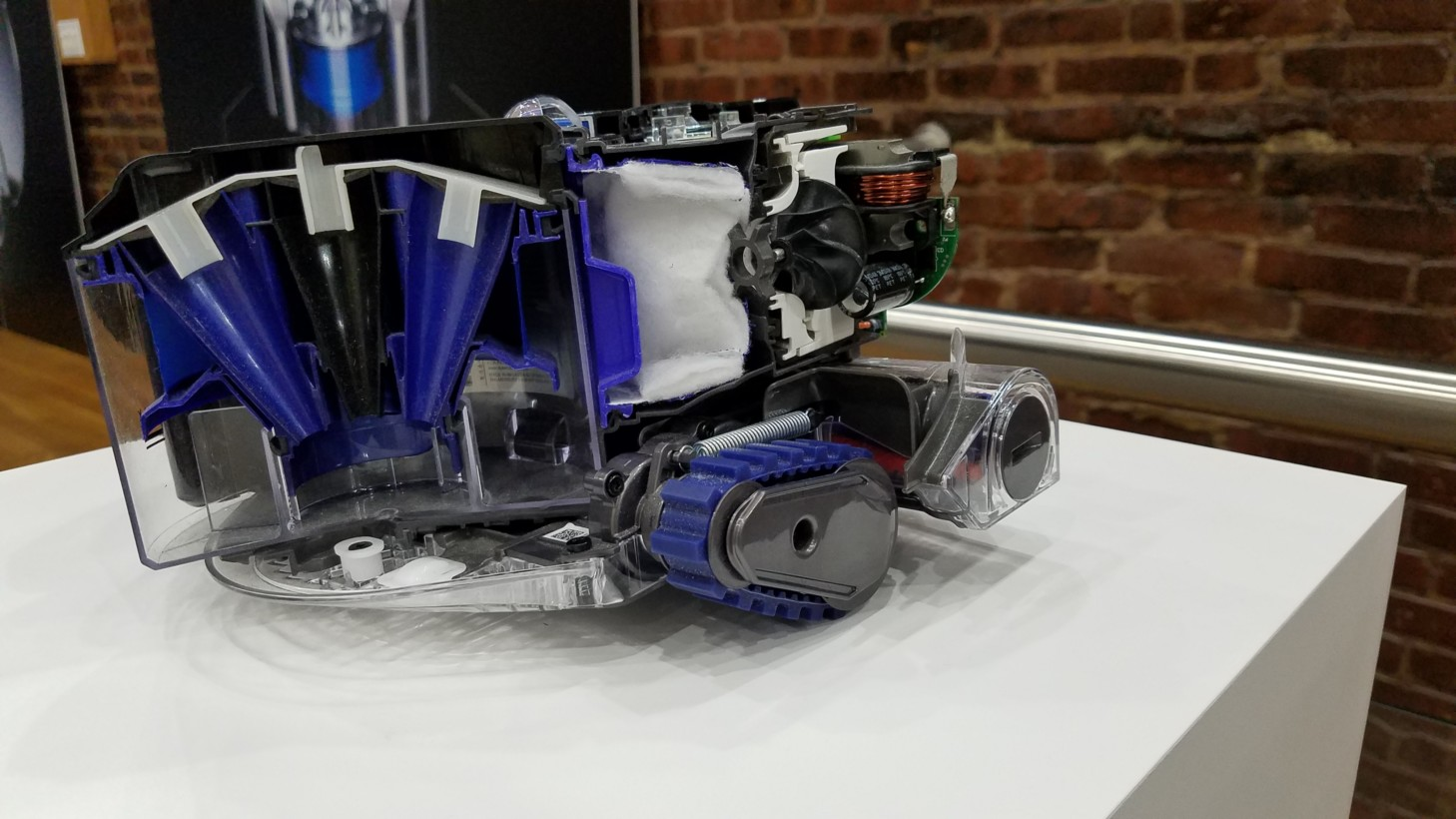A dissected Dyson 360 Eye which shows the Root Cyclone component, as well as the camera and motherboard