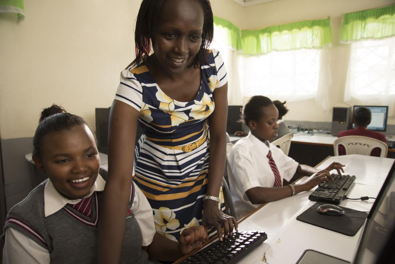 NAIROBI, KENYA - NOVEMBER 6 : DAMARIS, CAROLINE, AND SEVERAL STUDENTS WORKING ON APP IN COMPUTER LAB IN EMBAKASI GIRLS HIGH SCHOOL IN MUKURU AREA.  Photo by Guillaume Bonn/ Getty Images Assignment for intel