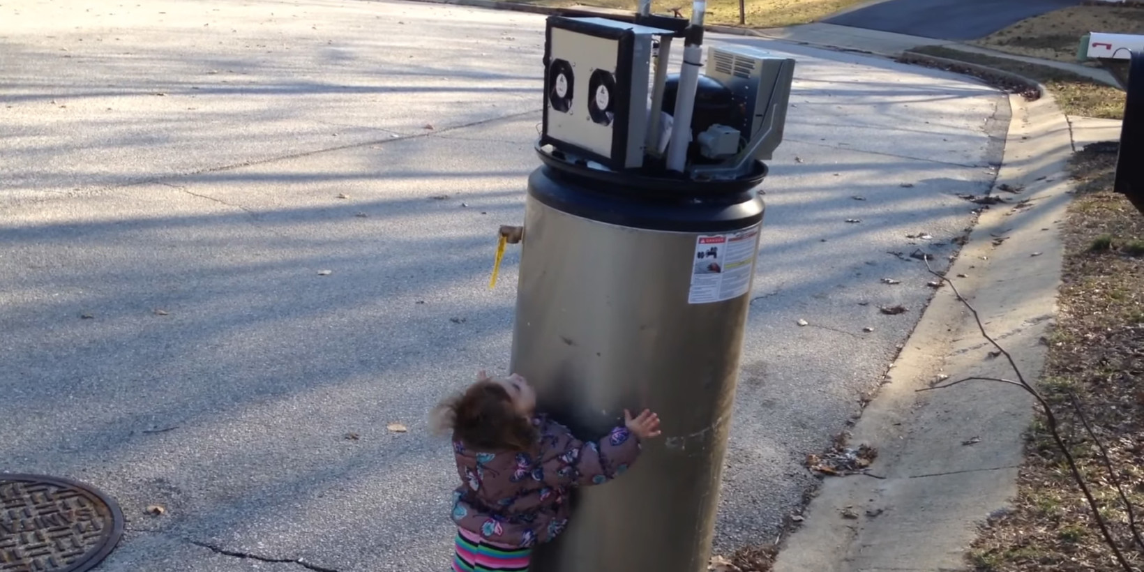 Let's Hope We Get Along with Robots as Well as this Kid and a Water Heater